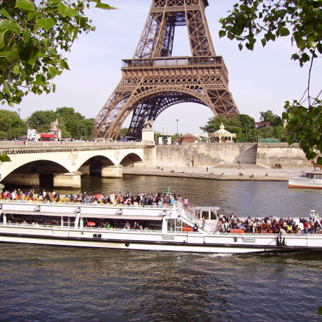 Bateau Mouche on river Seine near the Eiffel Tower in Paris France by Jean Pierre